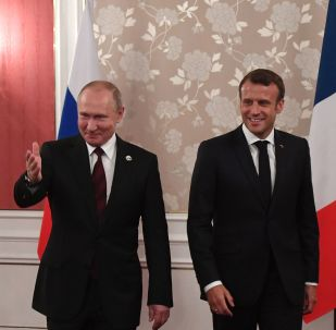 Vladimir Poutine et Emmanuel Macron (archives photo)