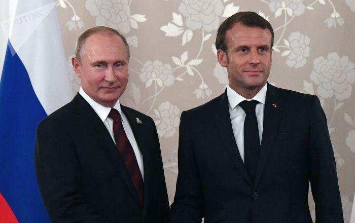 Vladimir Poutine et Emmanuel Macron à Osaka