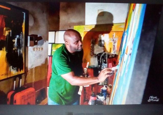 Mboko Lagriffe peignant une toile