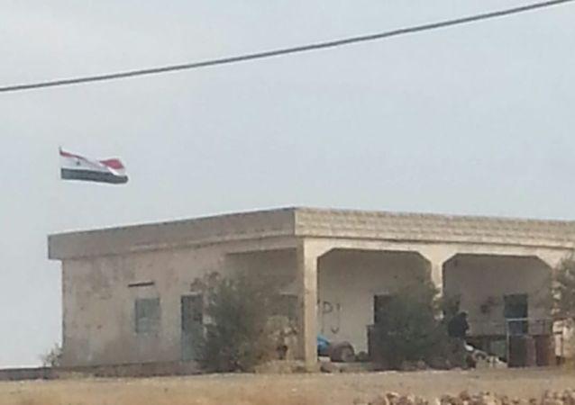 Le drapeau syrien hissé à Kobané