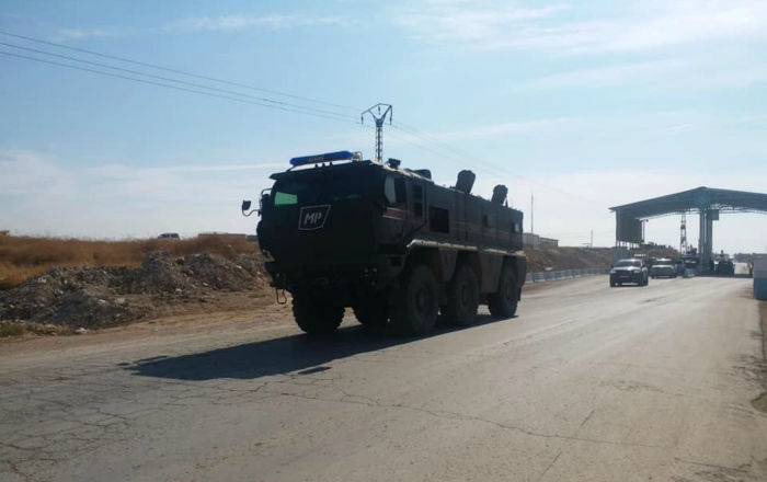 Pоссийская военная полиция прибыла в город Кобани на автомобилях с российскими флагами, 23 октября 2019