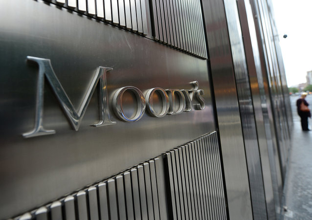 A sign for Moody's rating agency stands in front of the company headquarters in New York