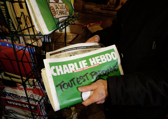 A seller of newspapers installs in shelf, several Charlie Hebdo newspapers at a newsstand in Nice southeastern France, Wednesday, Jan. 14, 2015