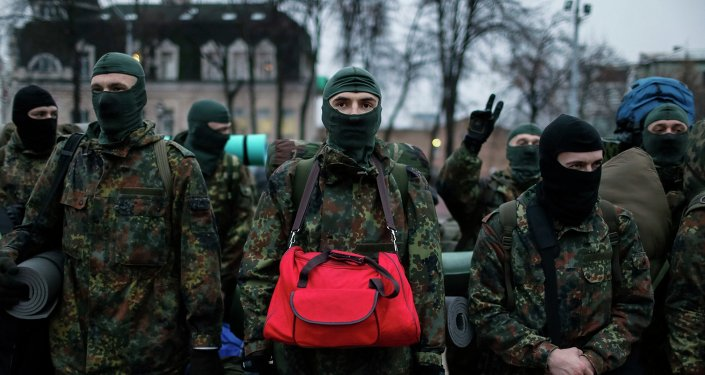 New volunteers for the Ukrainian Interior Ministry's Azov battalion line up before they depart to the frontlines in eastern Ukraine, in central Kiev January 17, 2015.