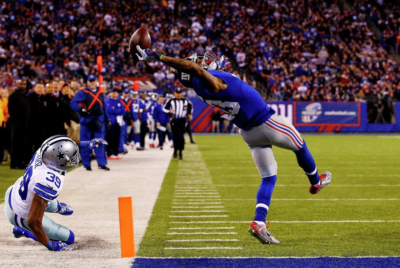 Odell Beckham, des Giants de New York, marque un touchdown contre les Cowboys de Dallas, au MetLife Stadium. Une photo d'Al Bello