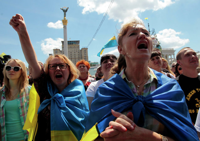 People shout slogans during a rally in Independence Square in Kiev, Ukraine, Sunday, June 29, 2014