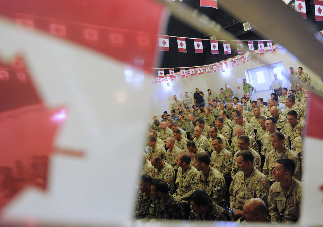 Canadian soldiers attend the handover ceremony to US forces at Kandahar airbase. File photo