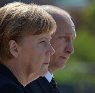 Vladimir Poutine (à droite) et Angela Merkel