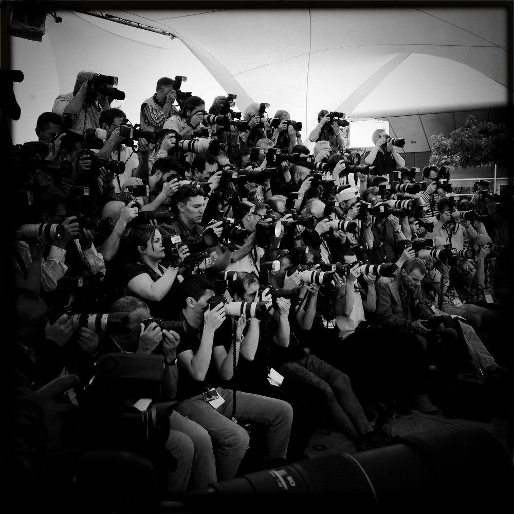 Des reporters photographes