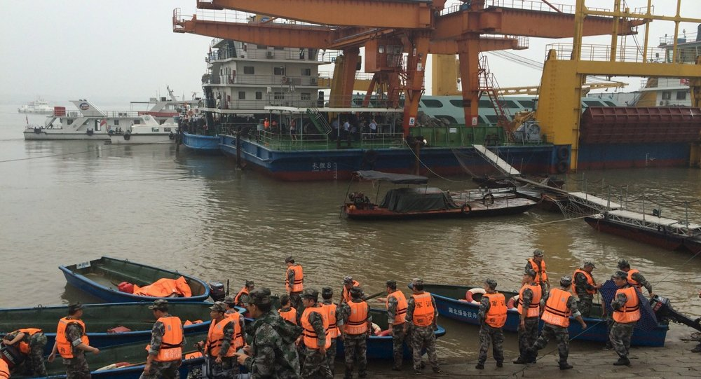 Rescue workers are seen near the site where a ship sank, in the Jianli section of the Yangtze River, Hubei province, China, June 2, 2015