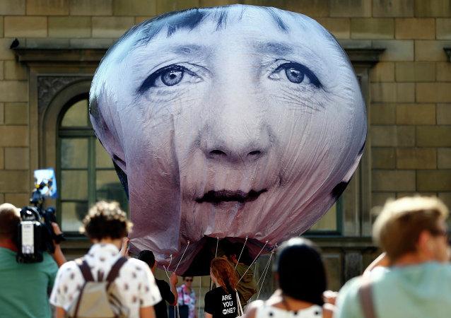 Ballon à l'effigie d'Angela Merkel