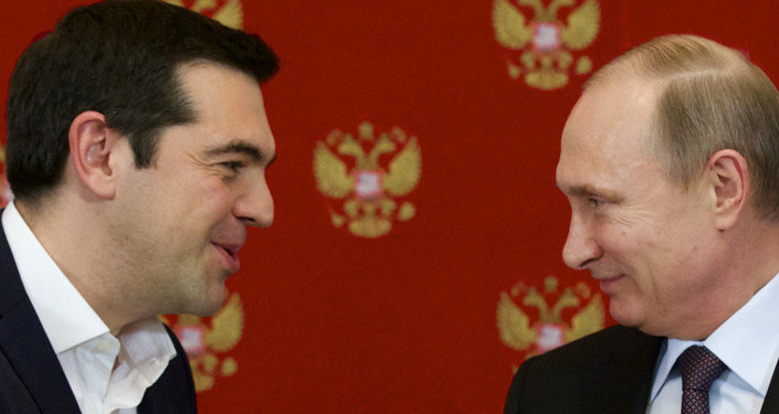 Russian President Vladimir Putin, right, and Greek Prime Minister Alexis Tsipras speak during a signing ceremony in the Kremlin