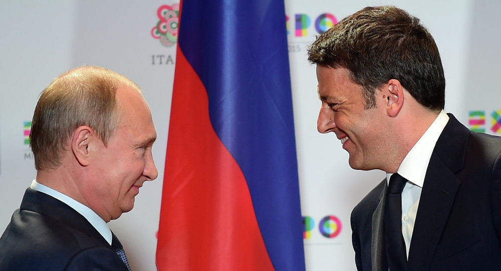 Russian President Vladimir Putin (L) shakes hands with Italian Prime Minister Matteo Renzi at the end of their press conference following a meeting and a visit at the Expo Milano 2015, the universal exhibition, on June 10, 2015 in Milan