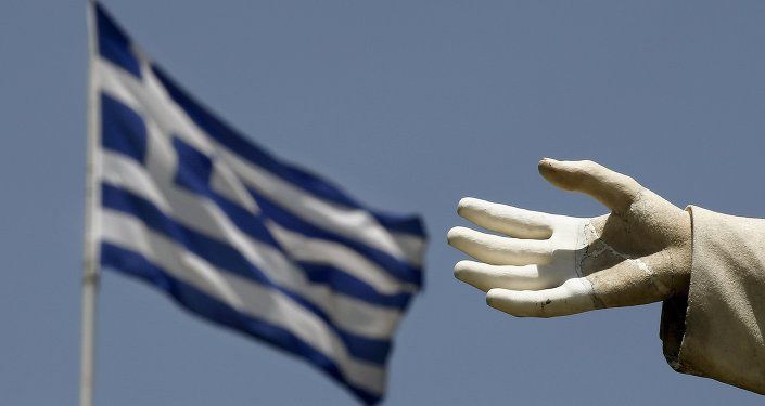 A Greek flag flutters by the hand of a statue of former British Prime Minister William Ewart Gladstone in Athens June 17, 2015.