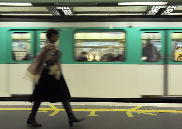 A woman walks on a plateform of Parisian subway as a train arrives, on October 28, 2010 in Paris.