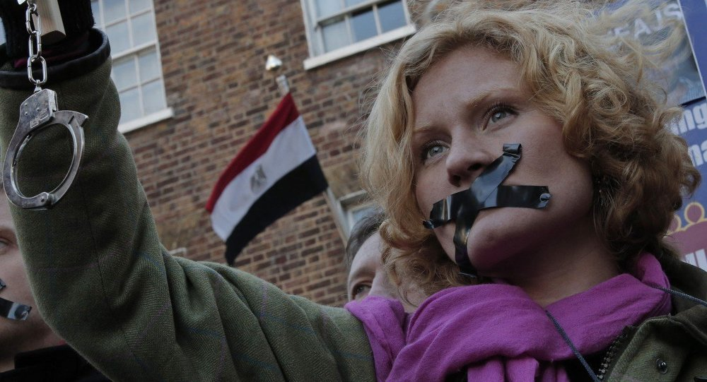 A journalist, with black tape over the mouth to illustrate the silencing of free speech and journalists