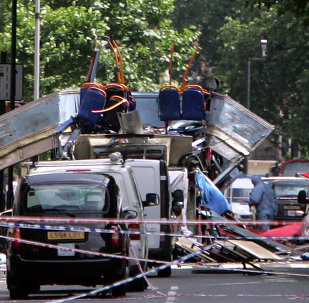 The remnants of a bus that exploded near Tavistock Square, in central London, Thursday July 7, 2005. Near simultaneous blasts on three subway trains and a red double-decker bus brought chaos to the streets of London Thursday