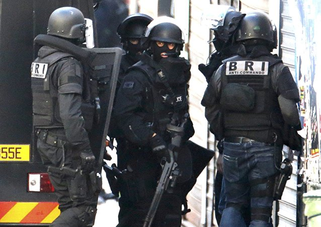 Members of French special police forces of Research and Intervention Brigade arrive during an operation in Saint-Denis, near Paris