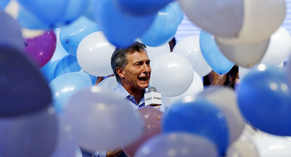 Mauricio Macri, presidential candidate of the Cambiemos (Let's Change) coalition, waves to his supporters after the presidential election in Buenos Aires, Argentina, November 22, 2015.