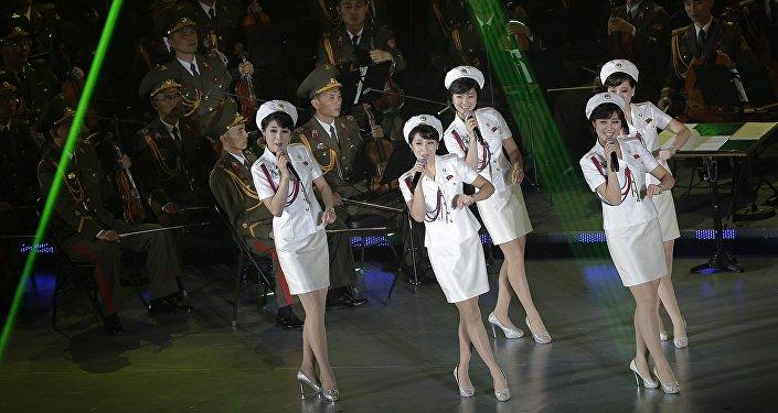 Singers from the Moranbong band and musicians from the State Merited Chorus perform in Pyongyang, North Korea, Sunday, Oct. 11, 2015.