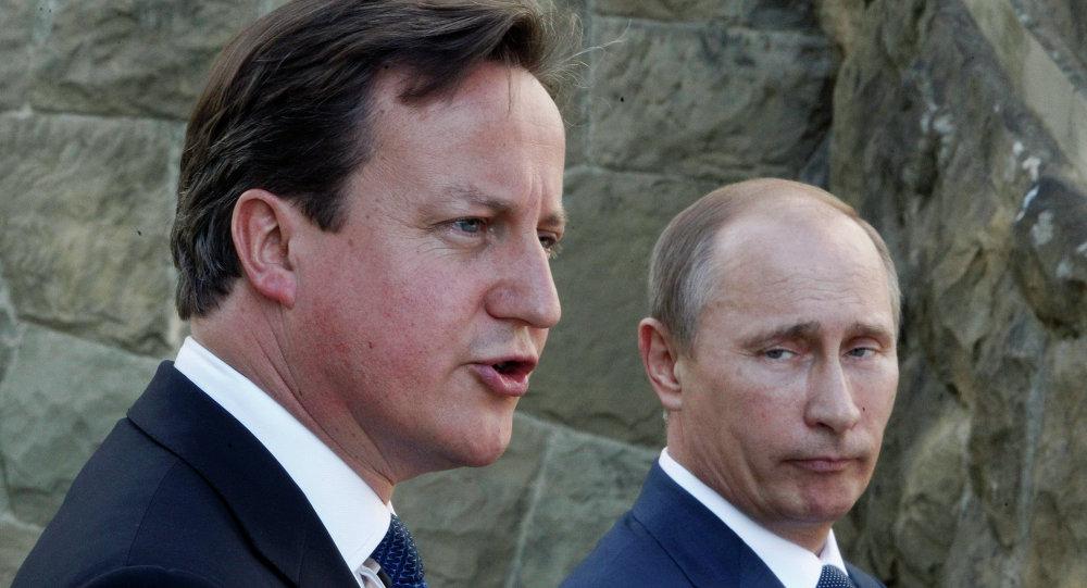 Le président russe Vladimir Poutine et le prémier-ministre britannique David Cameron