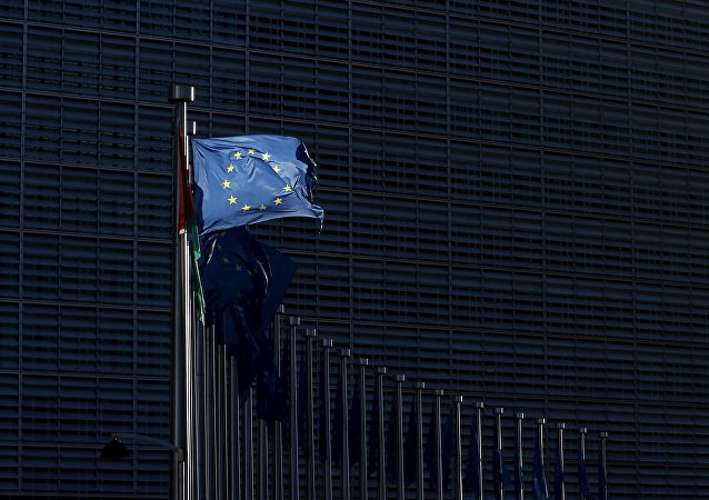 An European Union flag flutters outside the EU Commission headquarters in Brussels