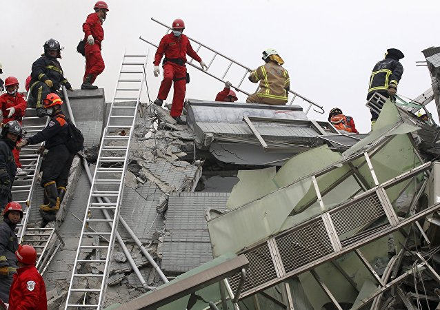 Rescue personnel work at the site where a 17-storey apartment building collapsed in an earthquake in Tainan, southern Taiwan, February 6, 2016