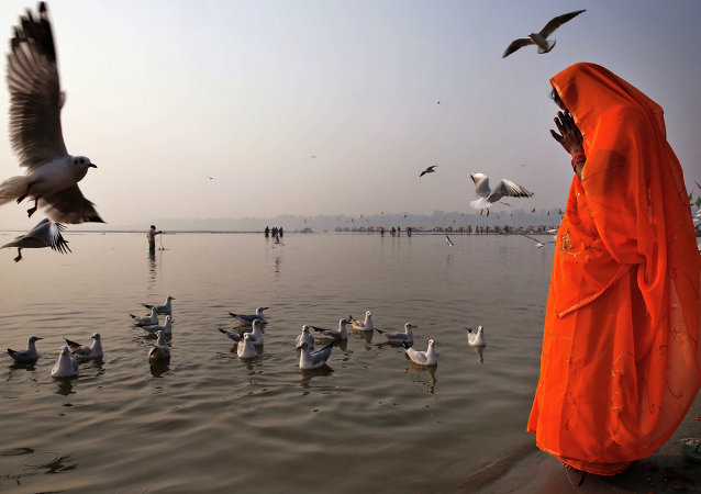 The Hindu prays on the bank of Ganges in Allahabad, India