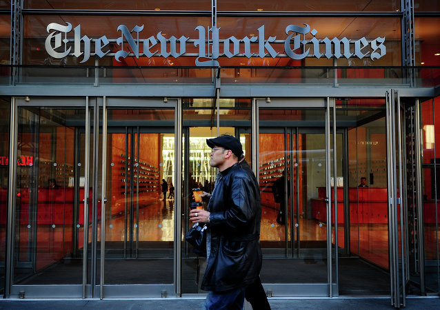 People walk by the entrance to US newspaper 'The New York Times' in New York