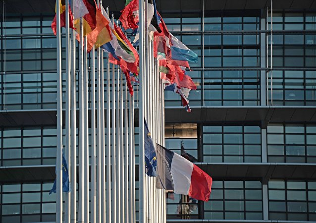 This photo taken on November 16, 2015 shows the French and European Union flags flying at half-mast in front of the European Parliament building in Strasbourg, eastern France, on November 16, 2015, as a tribute to victims of the November 13 attacks in Paris.