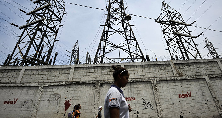 A woman walks in front of electricity pylons in Caracas, Venezuela (File)