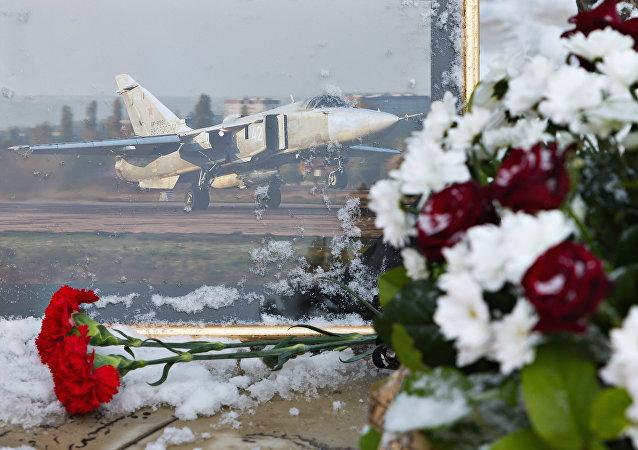 Les fleurs en la mémoire du pilote russe Oleg Pechkov du Su-24 abattu en Turquie