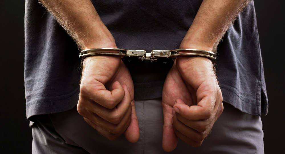 Detainee in handcuffs