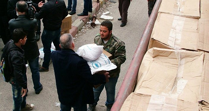 Distribution d'aide humanitaire russe dans la province syrienne de Lattaquié