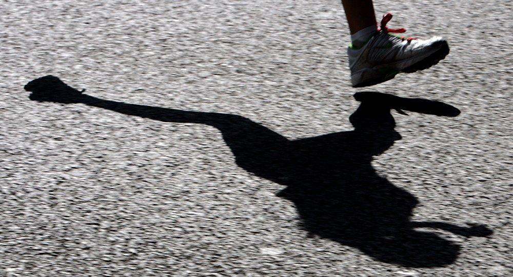Ombre d'un coureur. Image d'illustration