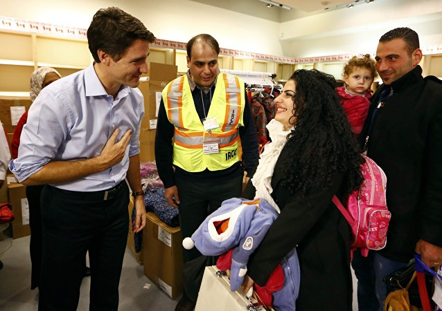 Réfugiés arrivent au Canada. Archive photo