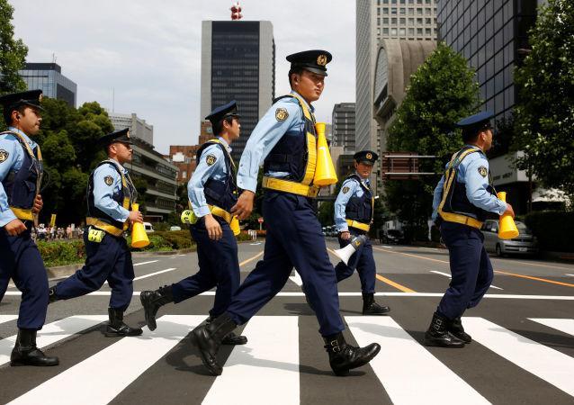 Des policiers à Tokyo