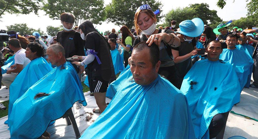 Se raser la tête, une forme de protestation contre le THAAD en Corée du Sud