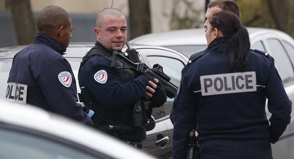 Police officers patrol near a pre-school in Paris suburb Aubervilliers on Monday, Dec.14, 2015.