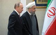 Les présidents russe et iranien Vladimir Poutine et Hassan Rohani