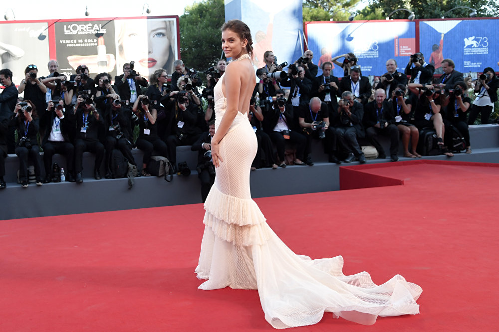 Model Barbara Palvin poses on the red carpet before the screening of the movie La La Land for the opening ceremony of the 73rd Venice Film Festival