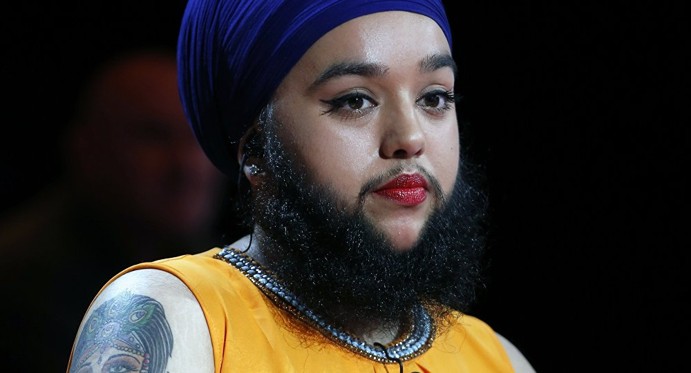 British Harnaam Kaur, known to have excess facial hair looks on during the show L'Emission d'Antoine hosted by French TV host Antoine de Caunes on the set of the French TV channel Canal+ on October 29, 2015 in Paris.