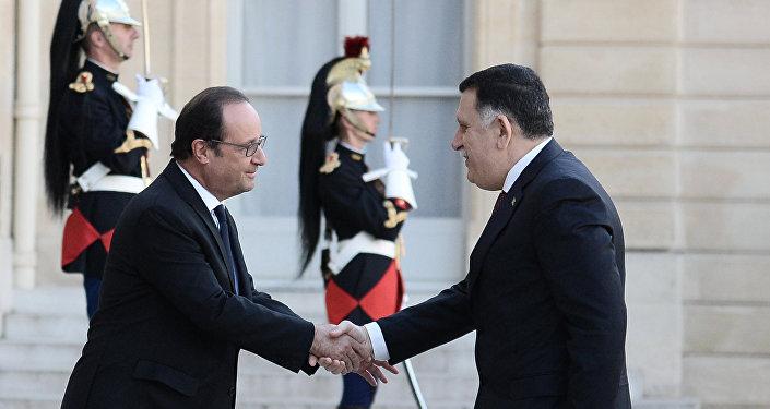 Hollande et al-Sarraj à l'Élysée