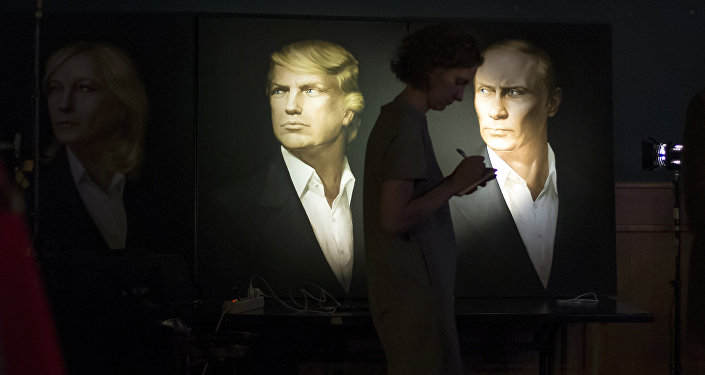 A journalist writes a material as she watches a live telecast of the U.S. presidential election standing at portraits of U.S. presidential candidate Donald Trump and Russian President Vladimir Putin in the Union Jack pub in Moscow, Russia, Wednesday, Nov. 9, 2016