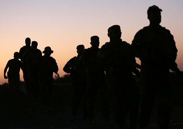 Shabak fighters undergo training before the upcoming battle to recapture Mosul in Diyala province