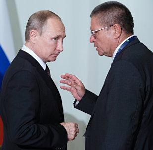 Vladimir Poutine et Alekseï Oulioukaïev