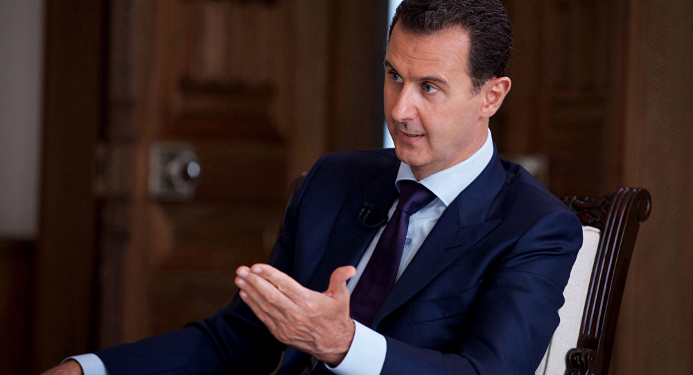 In this photo released on July 1, 2016, by the Syrian official news agency SANA, Syrian President Bashar Assad speaks during an interview with Australia's SBS news channel, in Damascus, Syria