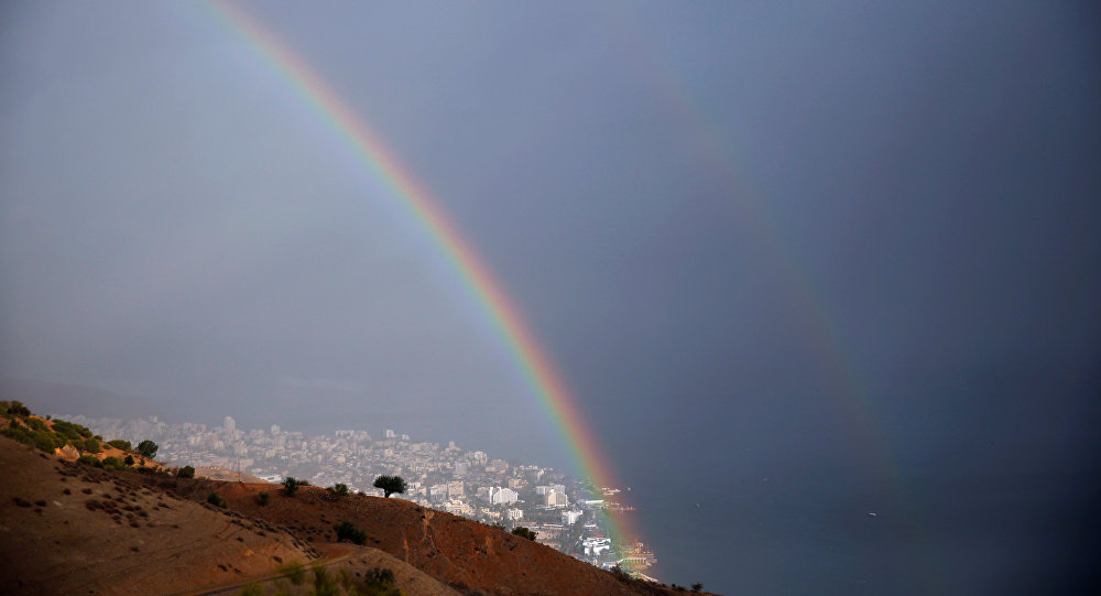 A rainbow is seen over the northern Israeli city of Tiberias, located near the Sea of Galilee December 1, 2016