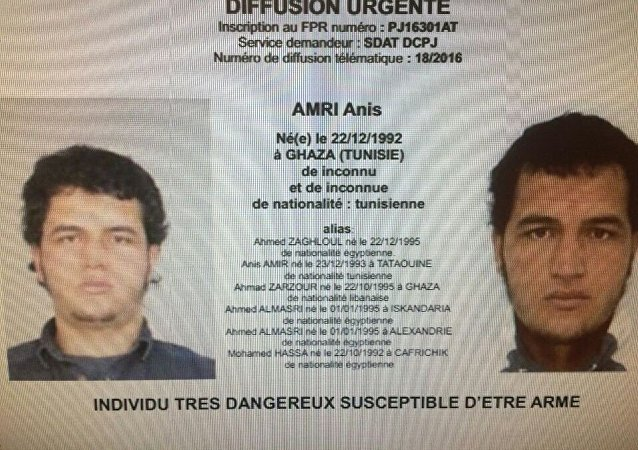 A police record with the title, Urgent Distribution (Top) and Very dangerous individual who could be armed (Bottom) shows suspect Anis Amri who is sought in relation with Monday's truck attack on a Christmas market in Berlin.