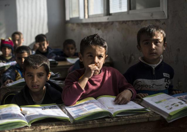 École dans un camp de réfugies en Syrie